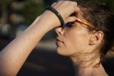 Woman adjusting Sunglasses www. InstantFashionMix.com A